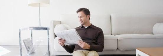 misverstanden over beleggen: man leest krant
